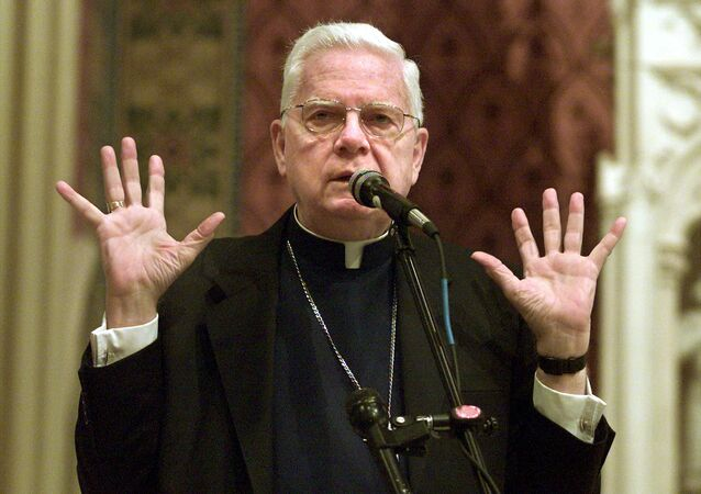 Boston's Roman Catholic Cardinal Bernard Law leads a prayer service for Boston area Catholic youth in Newton, Massachusetts, before joining them on a nine-hour bus ride to Toronto to see Pope John Paul II and attend World Youth Day July 23, 2002