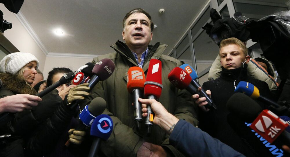 Ukrainian opposition figure and Georgian former President Mikheil Saakashvili (C) addresses journalists as he visits the General Prosecutor's Office in Kiev, Ukraine December 18, 2017