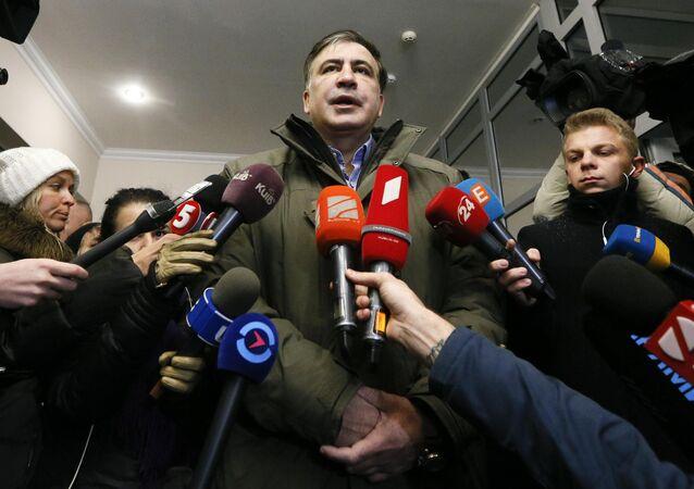 Ukrainian opposition figure and Georgian former President Mikheil Saakashvili (C) addresses journalists as he visits the General Prosecutor's Office in Kiev, Ukraine December 18, 2017
