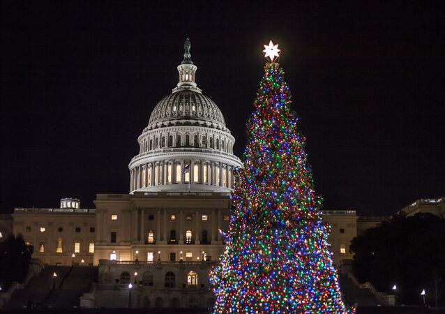 The Capitol Christmas tree is illuminated as lawmakers in the Senate work late into the evening on the Republican tax bill, in Washington, Tuesday, Dec. 19, 2017