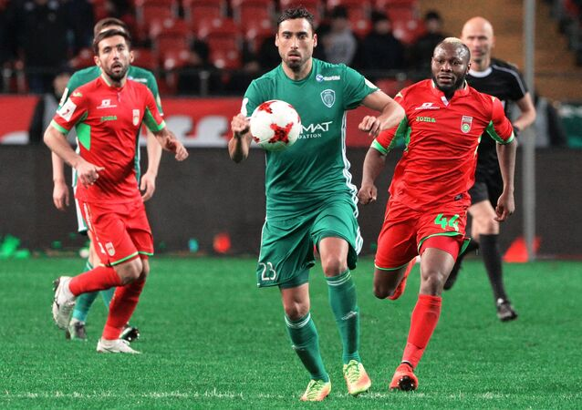 From right: Terek's Facundo Piriz and Ufa's Sylvester Igboun during the Russian Football Premier League's Round 18 match between Terek Grozny and Ufa