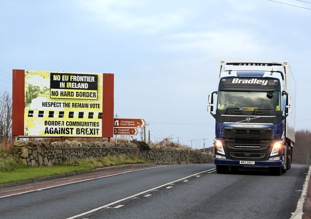 Traffic passing a Brexit Border poster on the Dublin road Co Armagh border, between Newry in Northern Ireland and Dundalk in the Irish Republic