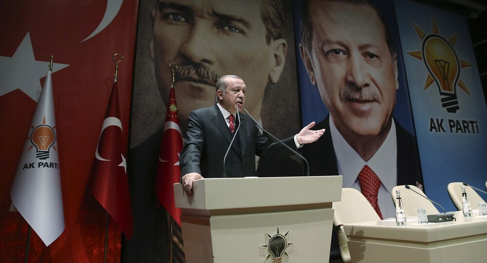 Backdropped by posters of Turkey's founding father Mustafa Kemal Ataturk, left, and himself, Turkey's President Recep Tayyip Erdogan addresses provincial leaders of his ruling Justice and Development Party (AKP), in Ankara, Turkey, Friday, Nov. 17, 2017