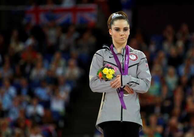 McKayla Maroney of the U.S. celebrates with her silver medal in the women's vault victory ceremony in the North Greenwich Arena during the London 2012 Olympic Games August 5, 2012