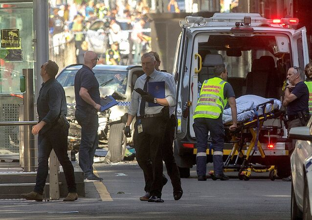 Australian police and paramedics are seen near the place where they arrested the driver of a vehicle that had ploughed into pedestrians at a crowded intersection near the Flinders Street train station, in central Melbourne, Australia, December 21, 2017