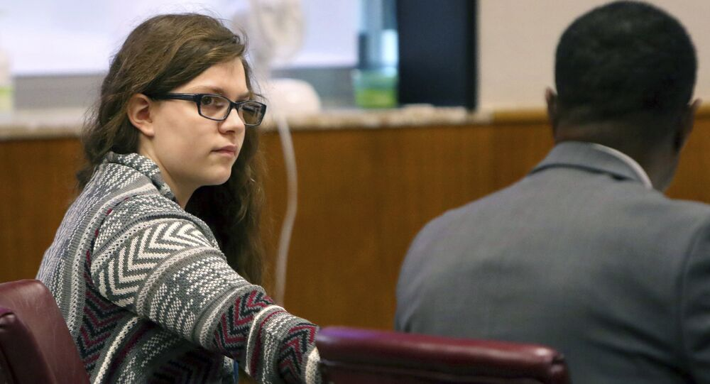 Anissa Weier passes a note to defense attorney Joseph Smith Jr. during closing arguments in her case before Waukesha County Circuit Court Judge Michael Bohren on Friday, Sept. 15, 2017, in Waukesha, Wis.