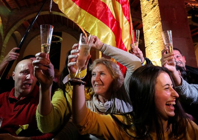 People react to results in Catalonia's regional elections at a gathering of the Catalan National Assembly (ANC) in Barcelona, Spain December 21, 2017