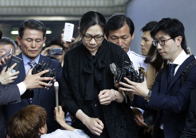 In this May 22, 2015, file photo, former Korean Air executive Cho Hyun-ah, center, is surrounded by reporters as she leaves the Seoul High Court in Seoul, South Korea