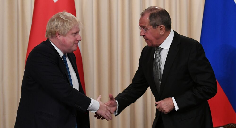Britain's Foreign Secretary Boris Johnson and his Russian counterpart Sergei Lavrov shake hands at a news conference following their meeting, in Moscow, Russia