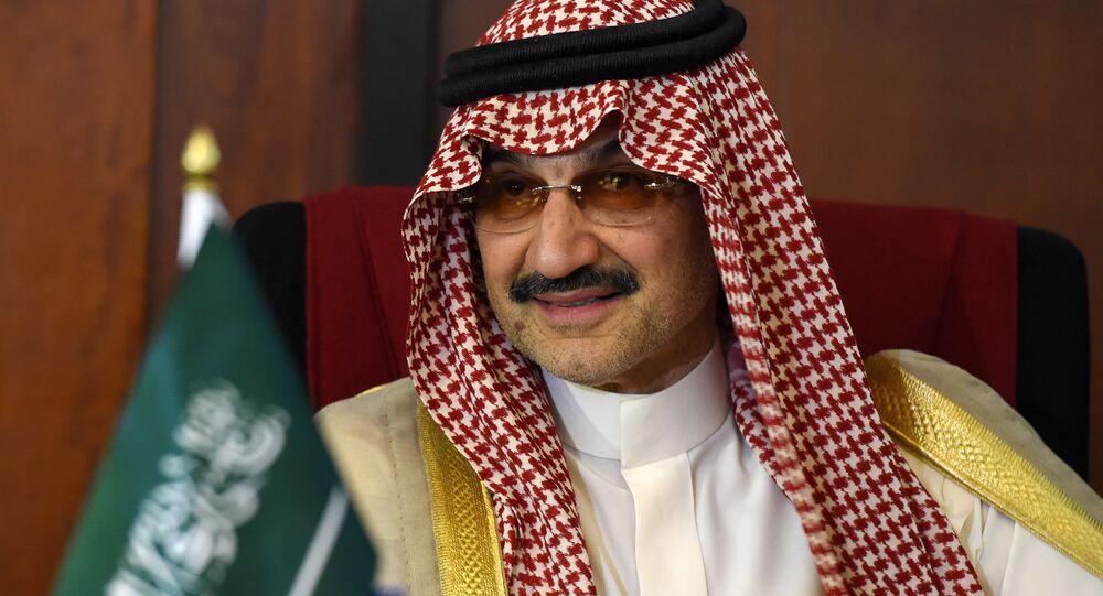 Saudi Arabian royal Al-Waleed Bin Talal bin Abdulaziz al Saud looks on during a meeting with Sri Lankan Foreign Minister Ravi Karunanayake in Colombo on July 4, 2017