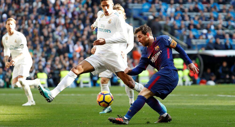 Soccer Football - La Liga Santander - Real Madrid vs FC Barcelona - Santiago Bernabeu, Madrid, Spain - December 23, 2017 Barcelona's Lionel Messi in action as Real Madrid's Raphael Varane attempts to block