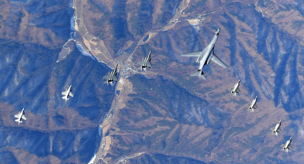 In this photo provided by South Korea Defense Ministry, U.S. Air Force B-1B bomber, center, flies over the Korean Peninsula with South Korean fighter jets F-16, F-15K and U.S. fighter jets F-35A, F35B during their combined aerial exercise Wednesday, Dec. 6, 2017. The United States flew a B-1B supersonic bomber over South Korea on Wednesday as part of a massive combined aerial exercise involving hundreds of warplanes, a clear warning after North Korea last week tested its biggest and most powerful missile yet.