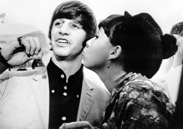 Angie McGowan, 16, plants a kiss on the cheek of Beatle drummer Ringo Starr after she returned his St. Christopher's medal in New York, on Aug. 29, 1964, which was torn from his neck in the arrival crowd.