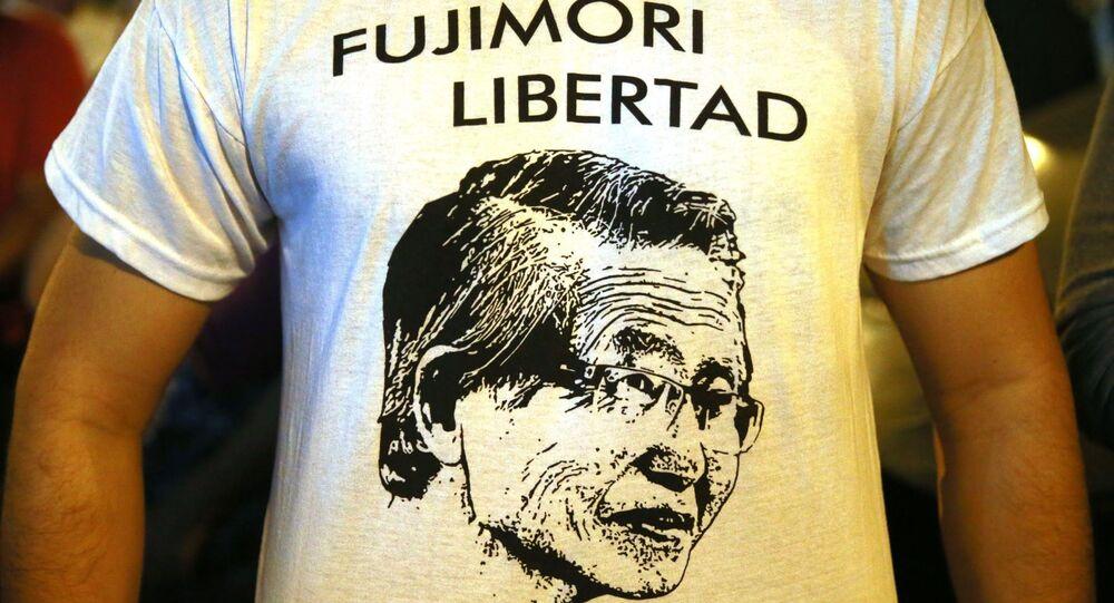 People celebrate in favor of Peru's ex-president Alberto Fujmori in Lima on December 24, 2017