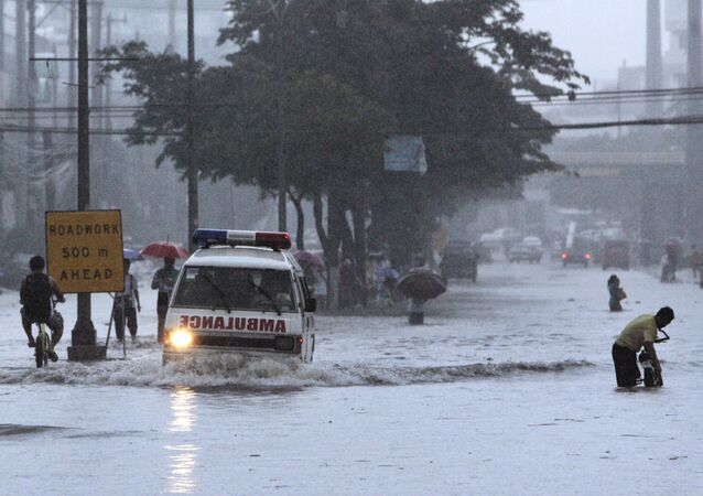 Am ambulance negotiates a flooded street , Philippines (File)