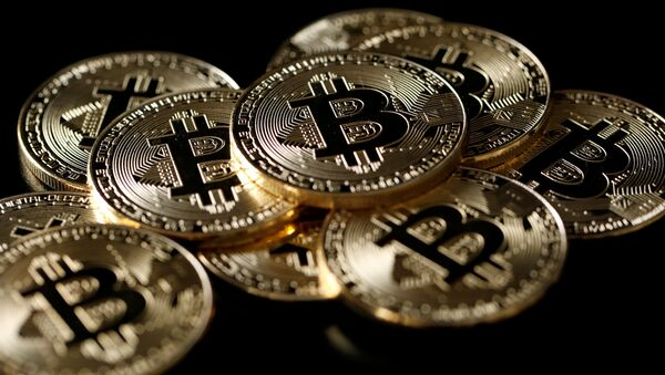 A collection of Bitcoin (virtual currency) tokens are displayed in this picture illustration taken December 8, 2017 - Sputnik International