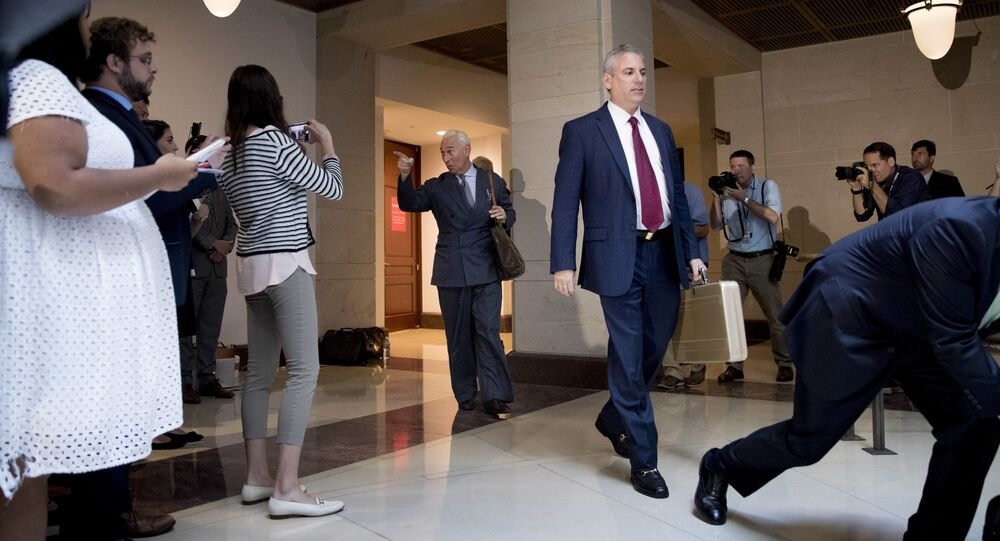 Longtime Donald Trump associate Roger Stone, center, arrives to speak to members of the media after testifying before the House Intelligence Committee, on Capitol Hill, Tuesday, Sept. 26, 2017, in Washington. Stone says there is not one shred of evidence that he was involved with Russian interference in the 2016 election. Stone's interview comes as the House and Senate intelligence panels are looking into the Russian meddling and possible links to Trump's campaign.
