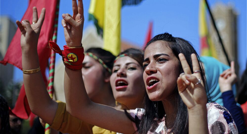 Supporters of the Kurdistan Workers' Party, known as the PKK, chant slogans as they flash victory signs during a demonstration demanding the release of Kurdish guerrilla leader Abdullah Ocalan, in front of the United Nations Headquarters in Beirut, Lebanon, Sunday, Sept. 24, 2017. Ocalan, the founder of the PKK, was captured in Kenya after being forced to leave a Greek diplomatic mission there in 1999, and was sentenced to death for leading an insurgency fighting for Kurdish autonomy in Turkey's southeast that has claimed tens of thousands of lives since 1984.