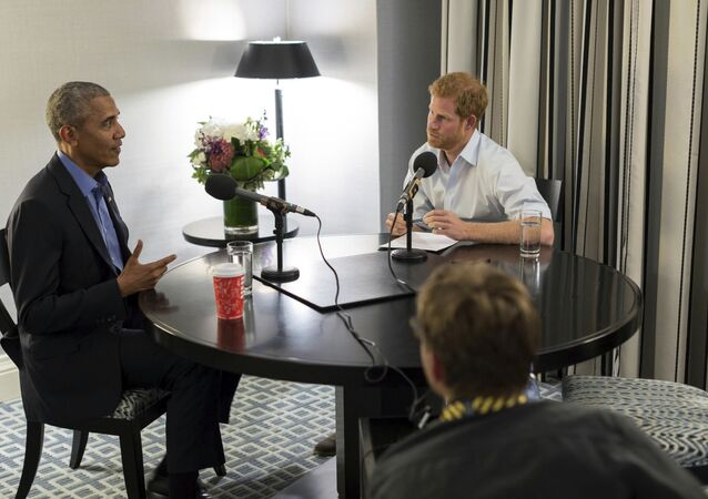 Britain's Prince Harry, right, interviews former US President Barack Obama as part of his guest editorship of BBC Radio 4's Today program