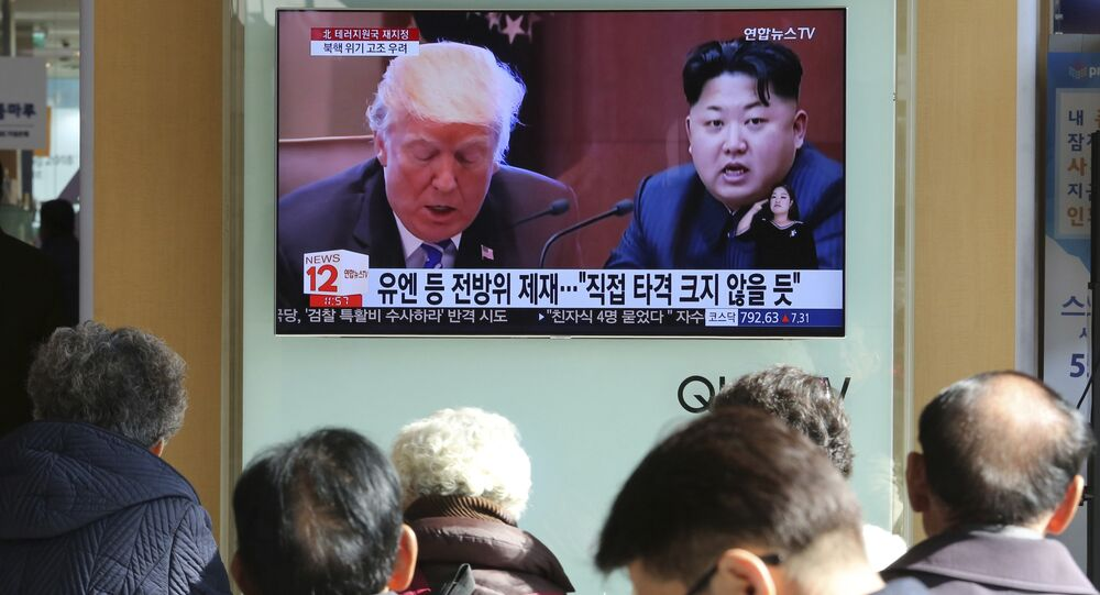 FILE- In this Tuesday, Nov. 21, 2017, file photo, people watch a TV screen showing images of U.S. President Donald Trump, left, and North Korean leader Kim Jong Un at Seoul Railway Station in Seoul, South Korea