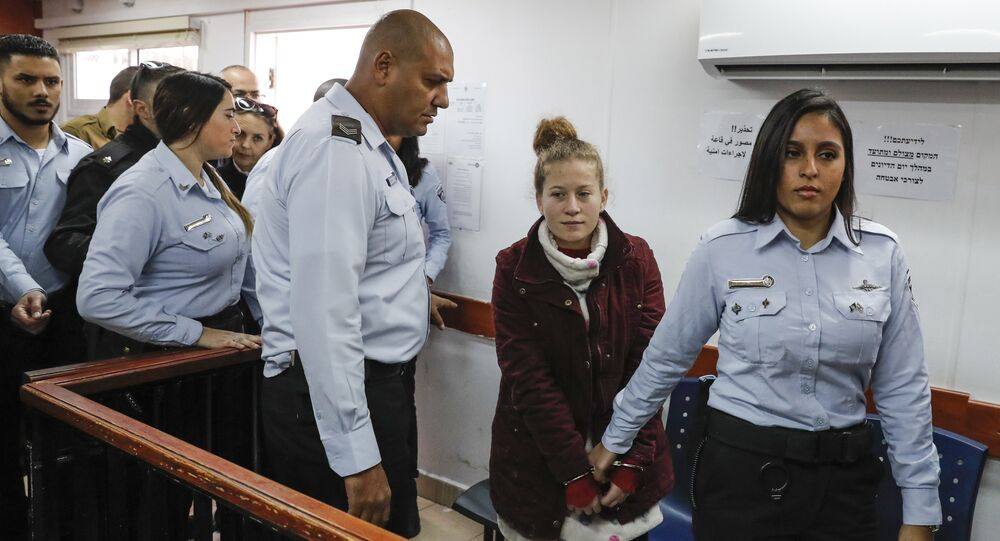 Ahed Tamimi (2nd-R), a prominent 17-year-old Palestinian campaigner against Israel's occupation, appears at a military court at the Israeli-run Ofer prison in the West Bank village of Betunia on December 25, 2017