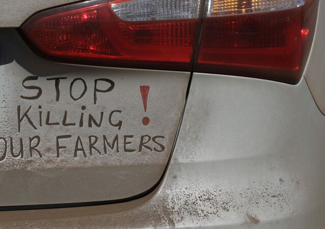 A bumper sign during a blockade of the freeway between Johannesburg and Vereeniging, in Midvaal, South Africa, in protest against the recent murder of farmers, Monday, Oct 30 2017