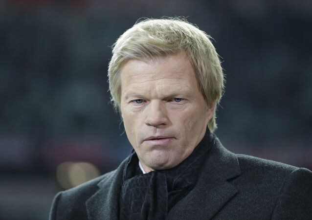 Former Bayern Munich goalkeeper and TV sports moderator Oliver Kahn is waiting for an interview prior to the soccer Champions League group F match between FC Bayern Munich and OSC Lille in Munich, Germany, Wednesday, Nov. 7, 2012