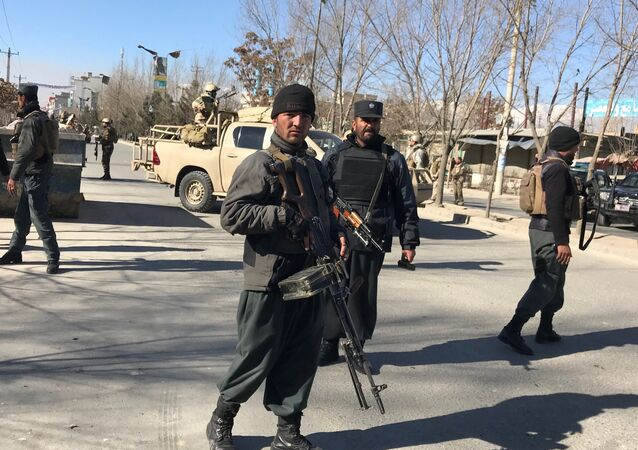 Afghan policemen stand guard at the site of a blast in Kabul, Afghanistan December 28, 2017