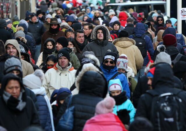 People bundle up against the cold temperature as they walk in Times Square in Manhattan, New York, U.S., December 28, 2017