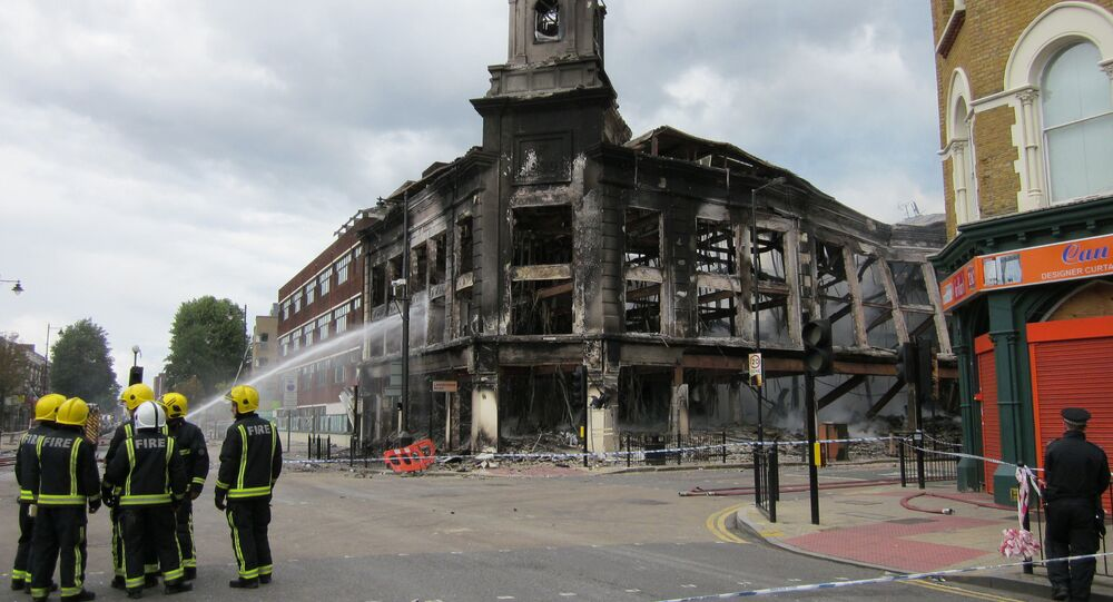 London riots: buildings burn on Tottenham High Road in 2011