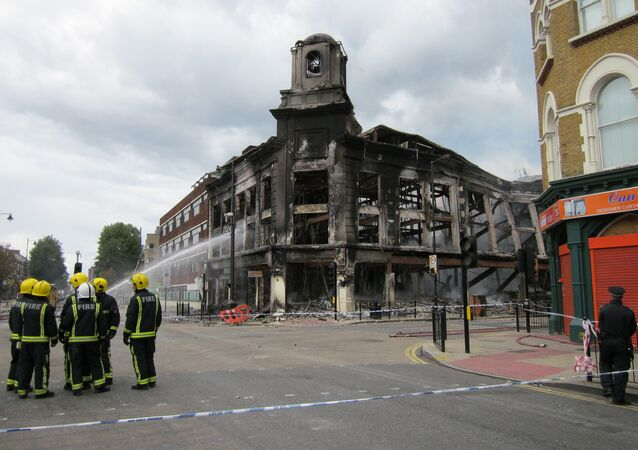 London riots: buildings burn on Tottenham High Road in 2011