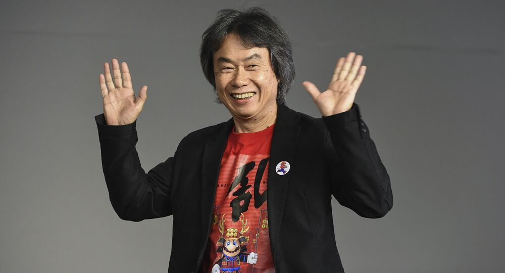 Japanese video game designer and producer Shigeru Miyamoto makes an appearance at the Apple SoHo store to promote Super Mario Run for iOS on Thursday, Dec. 8, 2016, in New York