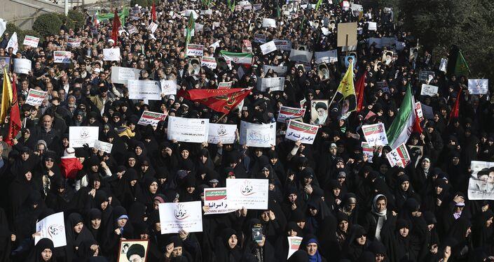Iranian protesters chant slogans at a rally in Tehran, Iran, Saturday, Dec. 30, 2017