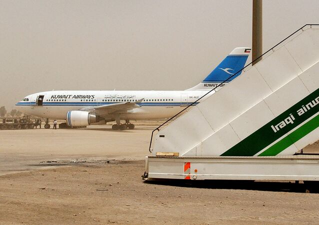 A Kuwait Airways airplane is refuelled at Baghdad International Airport on Sunday, May 18, 2003.