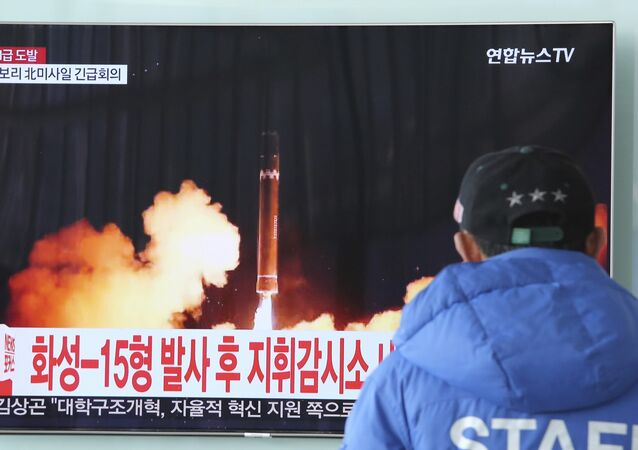 A man watches a TV screen showing what the North Korean government calls the Hwasong-15 intercontinental ballistic missile, at the Seoul Railway Station in Seoul, South Korea, Thursday, Nov. 30, 2017