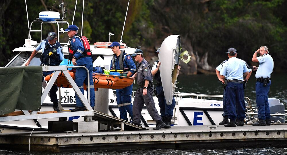 The body of a passenger recovered from a seaplane that crashed on Sunday killing six people, is carried by Australian police and medical officers, along with a piece of debris, at Apple Tree Bay located on the Hawkesbury River, north of Sydney in Australia, December 31, 2017