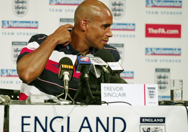 English Trevor Sinclair speaks to the medias after the team went through a light training run on the island of Awaji, near the port city of Kobe, 08 June 2002