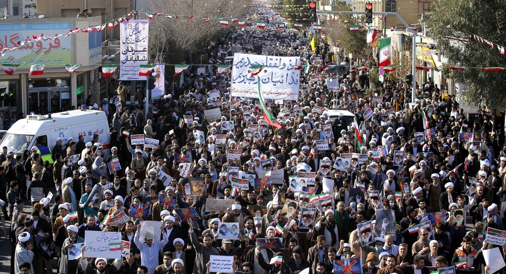 Pro-government demonstrators march in Iran's holy city of Qom, some 130 kilometres south of Tehran, on January 3, 2018