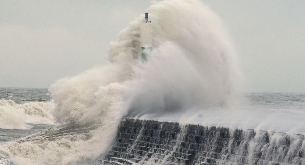 Waves crash over the stone jetty wall in Aberystwyth in west Wales as Storm Eleanor lashed Britain with violent storm-force winds of up to 100mph, leaving thousands of homes without power and hitting transport links Wednesday Jan. 3, 2018