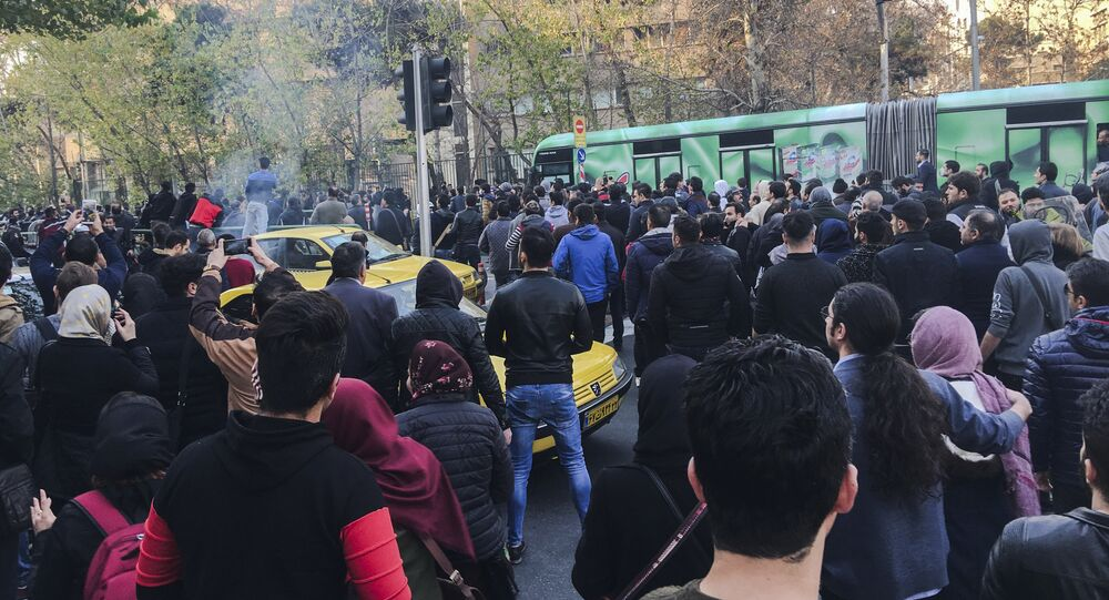 This photo taken by an individual not employed by the Associated Press and obtained by the AP outside Iran, demonstrators attend a protest over Iran's weak economy, in Tehran, Iran, Saturday, Dec. 30, 2017