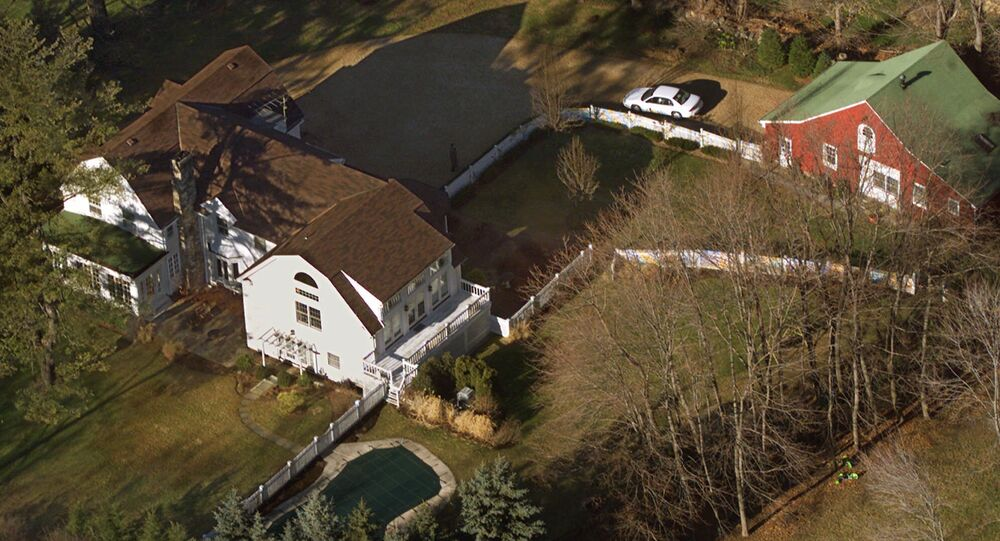 In this Jan. 5, 2000, file photo, the President Bill Clinton and Hillary Rodham Clinton's home is seen from the air in Chappaqua, N.Y.