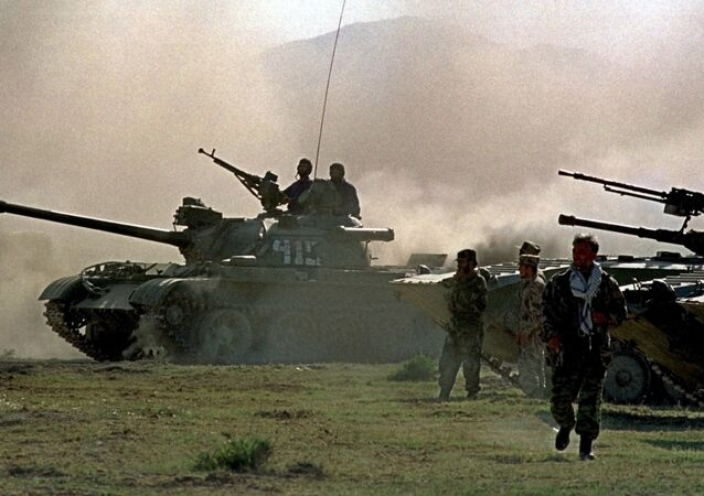 Northern alliance armor warm up their engines, during preparations for an offensive against Afghanistan's Taliban movement in Takhar province, some 15 km (9 miles) from the Tajik-Afghan border in Afghanistan, Thursday, Oct. 4, 2001. The opposition alliance in northern Afghanistan is coordinating its offensive with the United States, an opposition spokesman said Wednesday, and it is expecting fresh arms deliveries from two of its strongest allies in the fight against the Taliban: Iran and Russia.