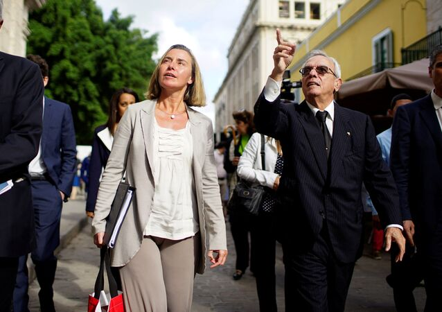 European Union's diplomat Federica Mogherini (2nd L) speaks to Eusebio Leal (2nd R), a leading intellectual and the official historian of the city of Havana as they walk through Old Havana, Cuba, January 3, 2018