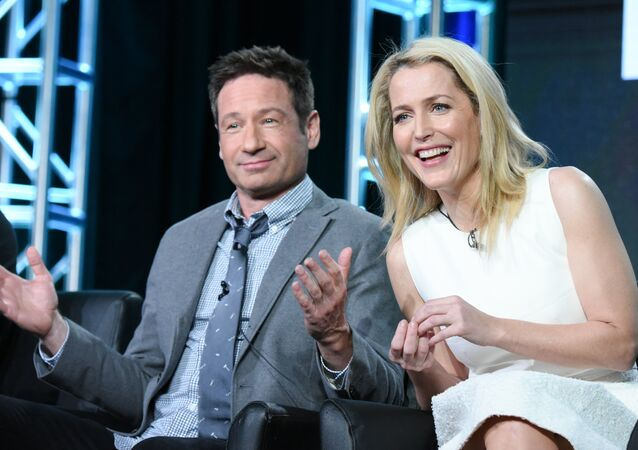 Actors David Duchovny, left, and Gillian Anderson participate in The X Files panel at the Fox Winter TCA on Friday, Jan. 15, 2016, Pasadena, Calif.