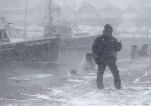 The Weather Channel on-camera meteorologist Jim Cantore stands at the Sandy Bay Yacht club as he reports on severe weather in Rockport, Mass., on Thursday, Jan. 4, 2018.