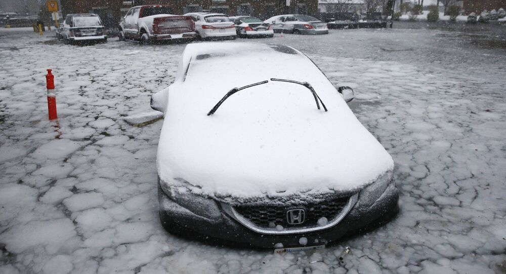 car sits in floodwaters from Boston Harbor on Long Wharf in Boston, Thursday, Jan. 4, 2018. A massive winter storm swept from the Carolinas to Maine on Thursday, dumping snow along the coast and bringing strong winds that will usher in possible record-breaking cold.