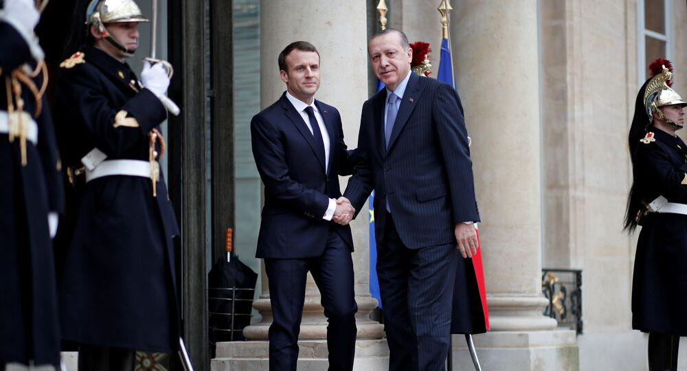 French President Emmanuel Macron welcomes Turkey's President Tayyip Erdogan at the Elysee Palace in Paris, France, January 5, 2018