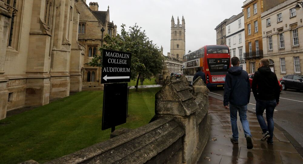 In this Sunday, Sept. 3, 2017 photo, people walk around Oxford University's campus in Oxford, England