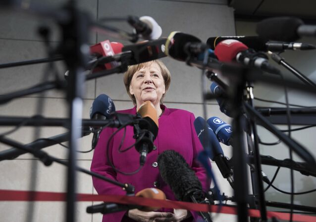 German chancellor Angela Merkel delivers a statement in Berlin, Sunday, Jan. 7, 2018. German Chancellor Angela Merkel embarked Sunday on talks with the center-left Social Democrats on forming a new government, with leaders stressing the need for speed as they attempt to break an impasse more than three months after the country's election.