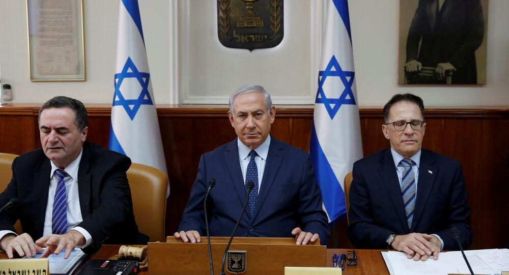 Israeli Prime Minister Benjamin Netanyahu (C) sits next to Cabinet Secretary Tzachi Braverman (R) and Israeli Intelligence and Transportation Minister Israel Katz (L) at the start of the weekly cabinet meeting at the Prime Minister's office in Jerusalem January 7, 2018